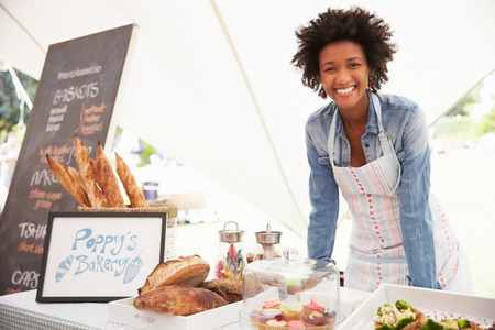 42131685 - female bakery stall holder at farmers fresh food market