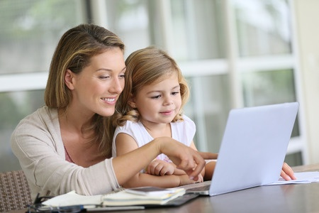 34728869 - little girl looking at laptop computer with her mom